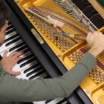 Overhead image of piano tuning